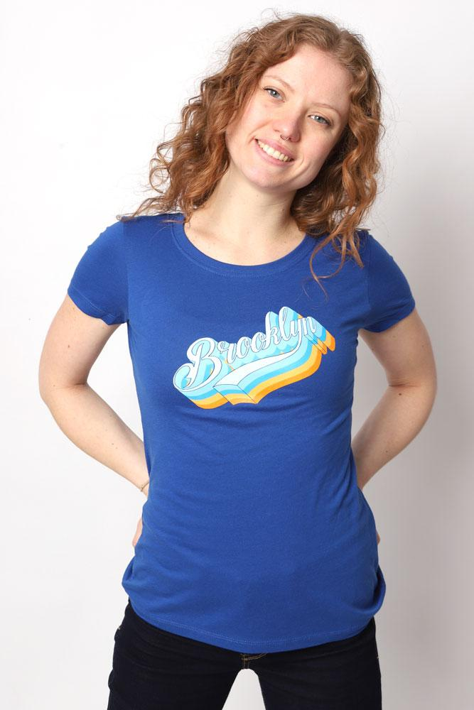 Women smiles wearing blue t-shirt with Platform Script on the chest in blue