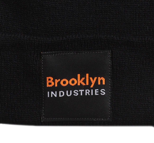 DETAIL OF BROOKLYN INDUSTRIES VINTAGE LABEL ON BLACK HAT