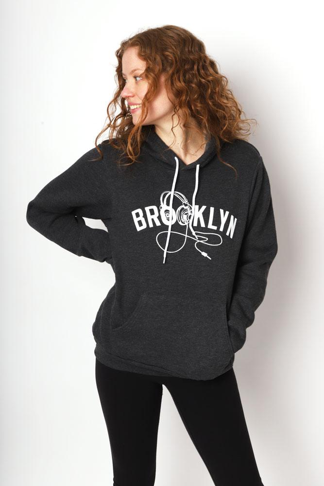 Women looks to the side with a grey BK PHONES hoodie on.