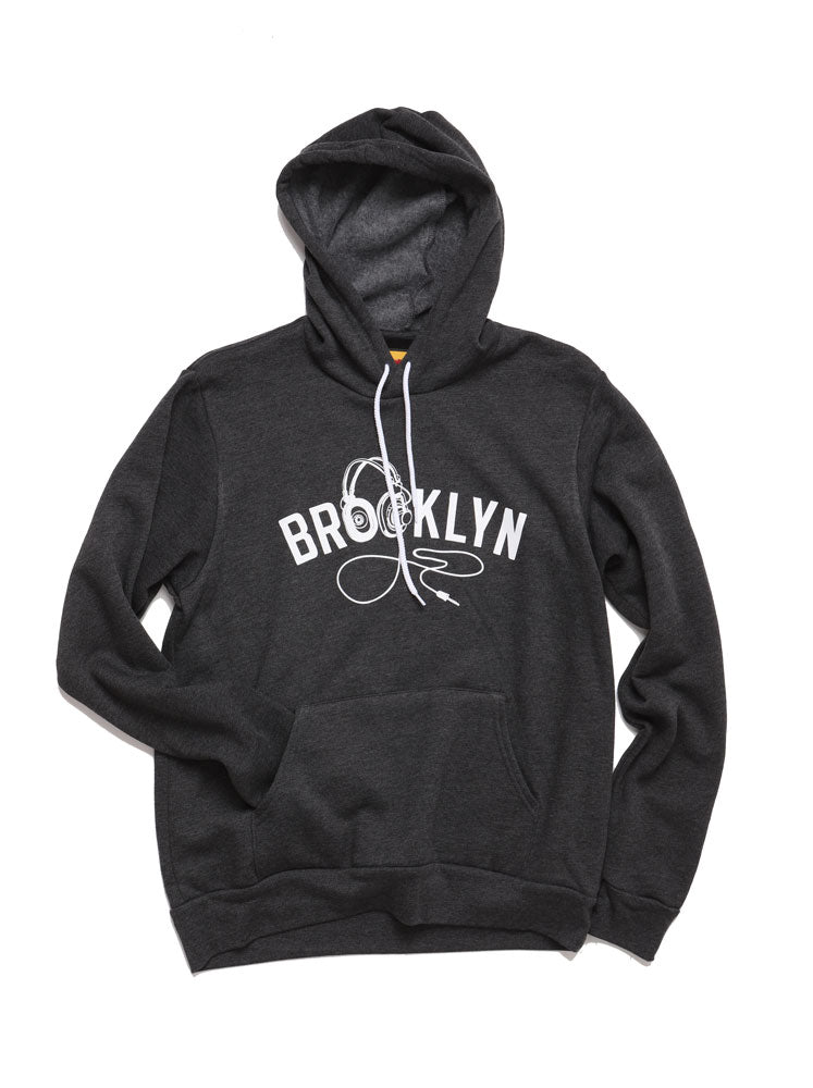 BROOKLYN INDUSTRIES UNISEX GREY HOODED SWEATSHIRT WITH HOOD UP, GRAPHIC ON CHEST IS TEXT BROOKLYN WITH HEADPHONES AS THE O'S