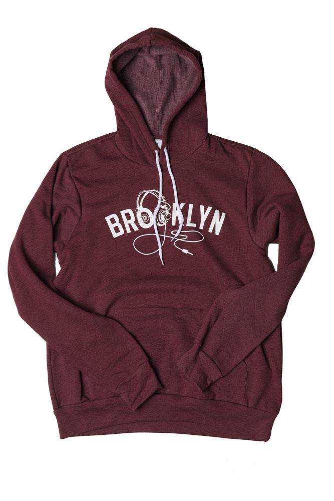 BROOKLYN INDUSTRIES UNISEX PLUM HOODED SWEATSHIRT WITH HOOD UP, GRAPHIC ON CHEST IS TEXT BROOKLYN WITH HEADPHONES AS THE O'S