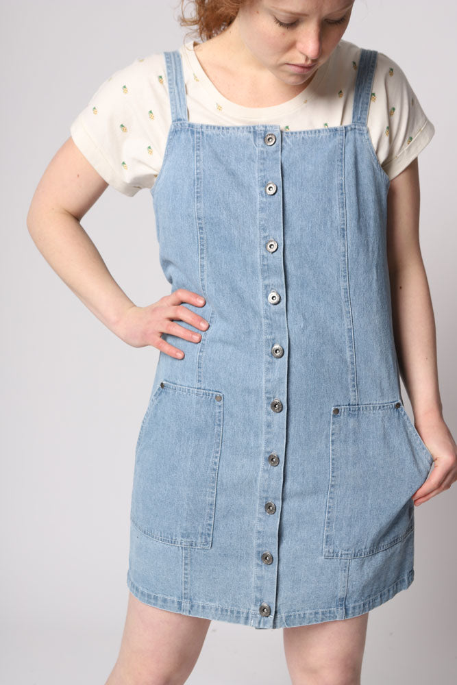 DENIM JUMPER DRESS WITH BUTTONS DOWN THE FRONT, AND POCKETS ON THE BACK