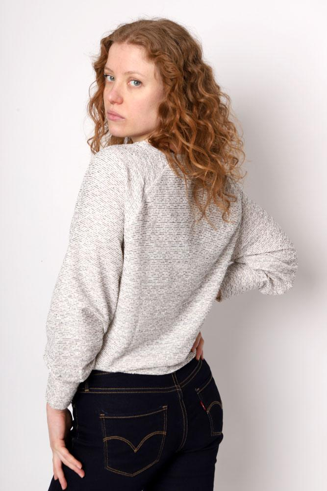 Women looks over her shoulder in the Born To Tie Sweatshirt