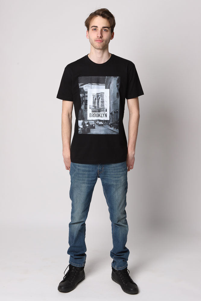 Man in black t-shirt with Brooklyn Bridge graphic