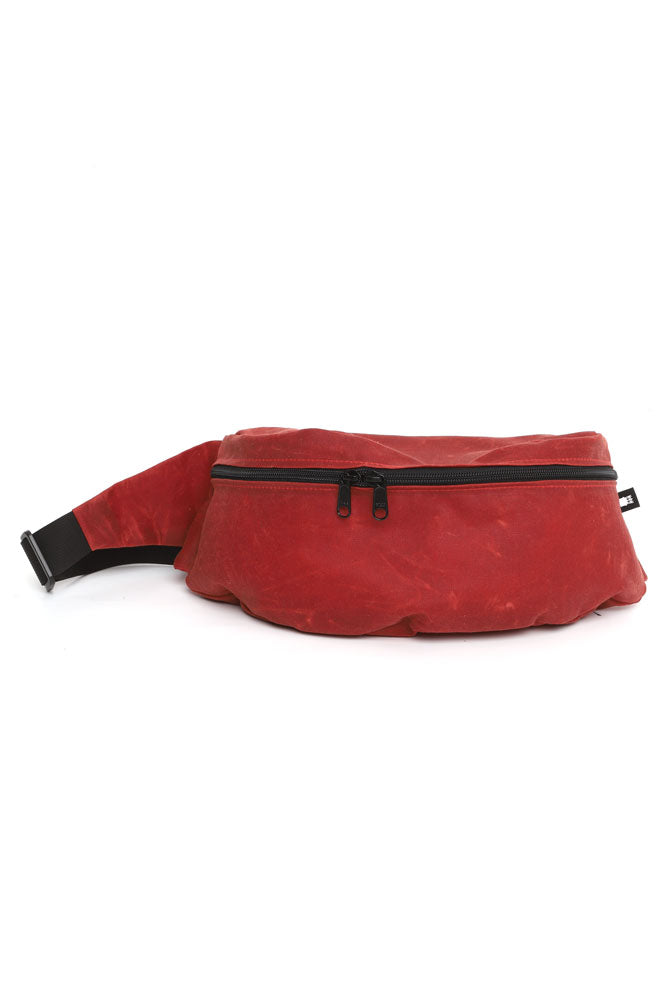 ZEKI WAISTPACK IN BURGUNDY WAXED CANVAS