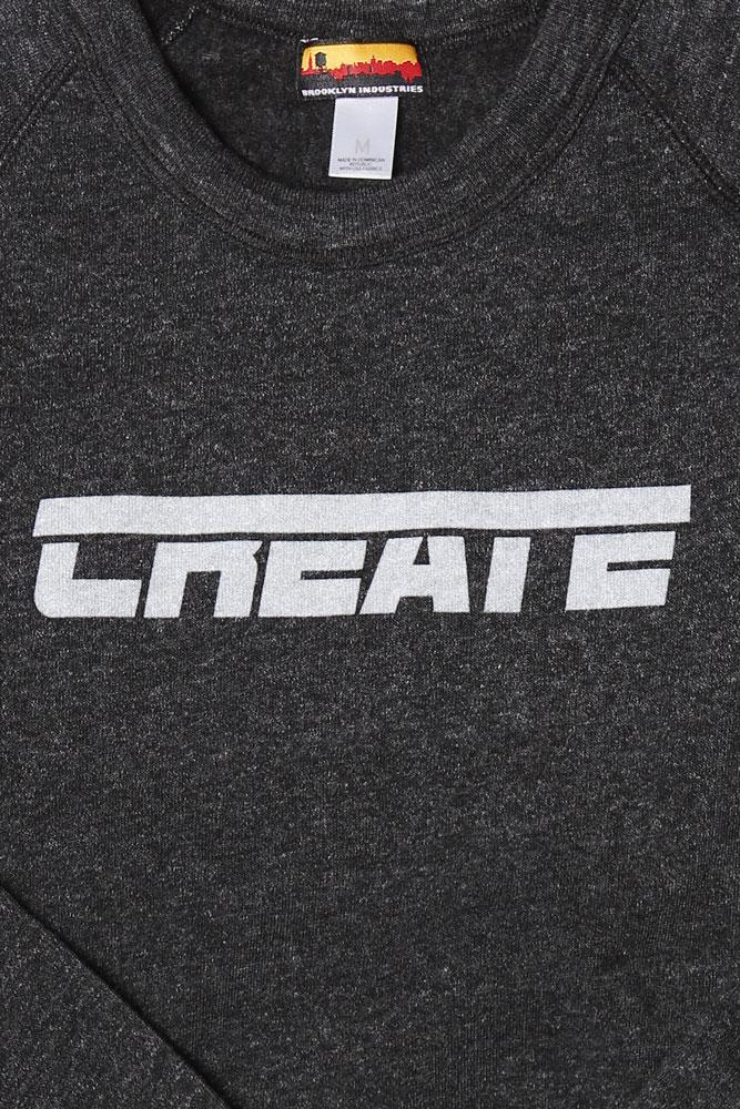 detail of  grey men's sweatshirt with text CREATE on the chest