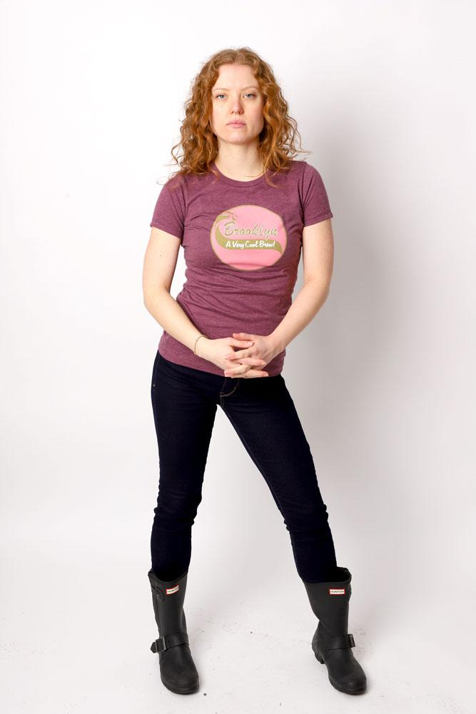 Women wears rain boots and black pants in maroon Cool Brew graphic t-shirt