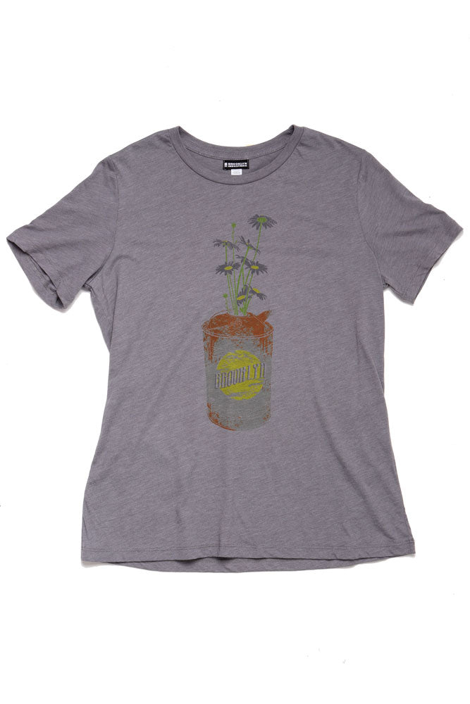 FLAT LAY OF THE DAISY CAN T-SHIRT FOR WOMEN