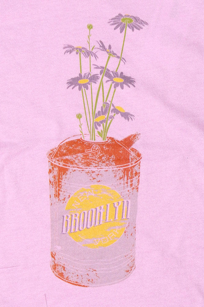 DETAIL OF RUSTED TIN CAN WITH BROOKLYN TEXT AND VINTAGE DAISIES  ON LILAC YOUTH SHIRT