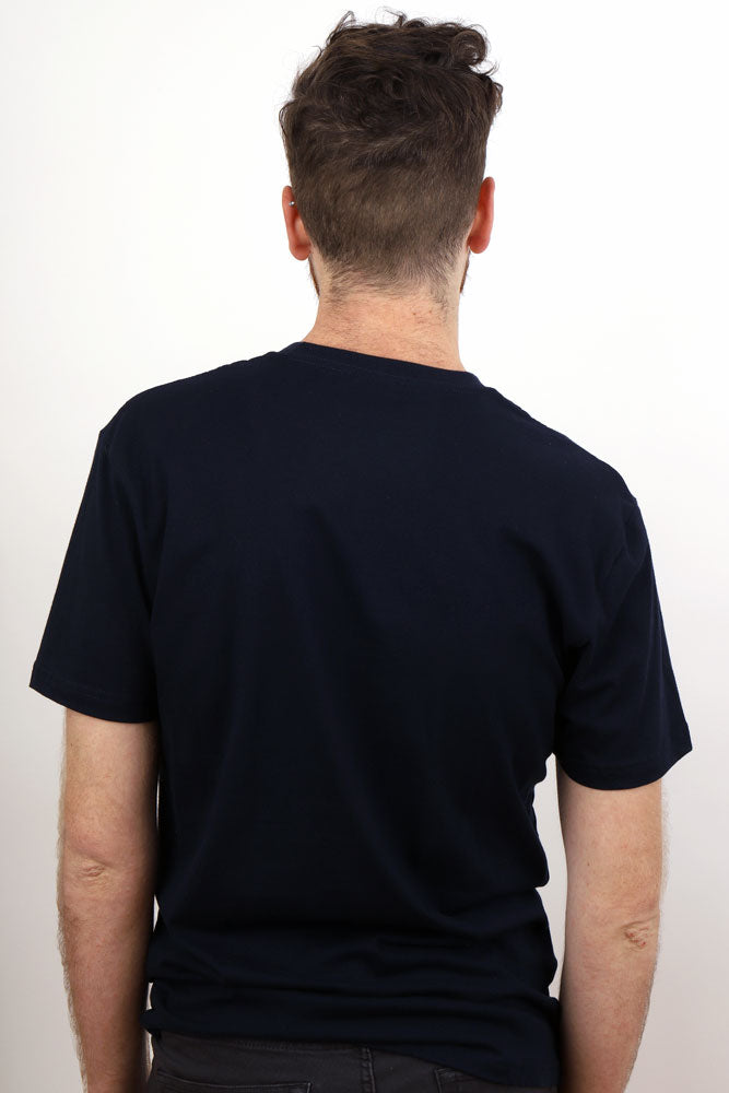 Back view of a man in a navy tshirt
