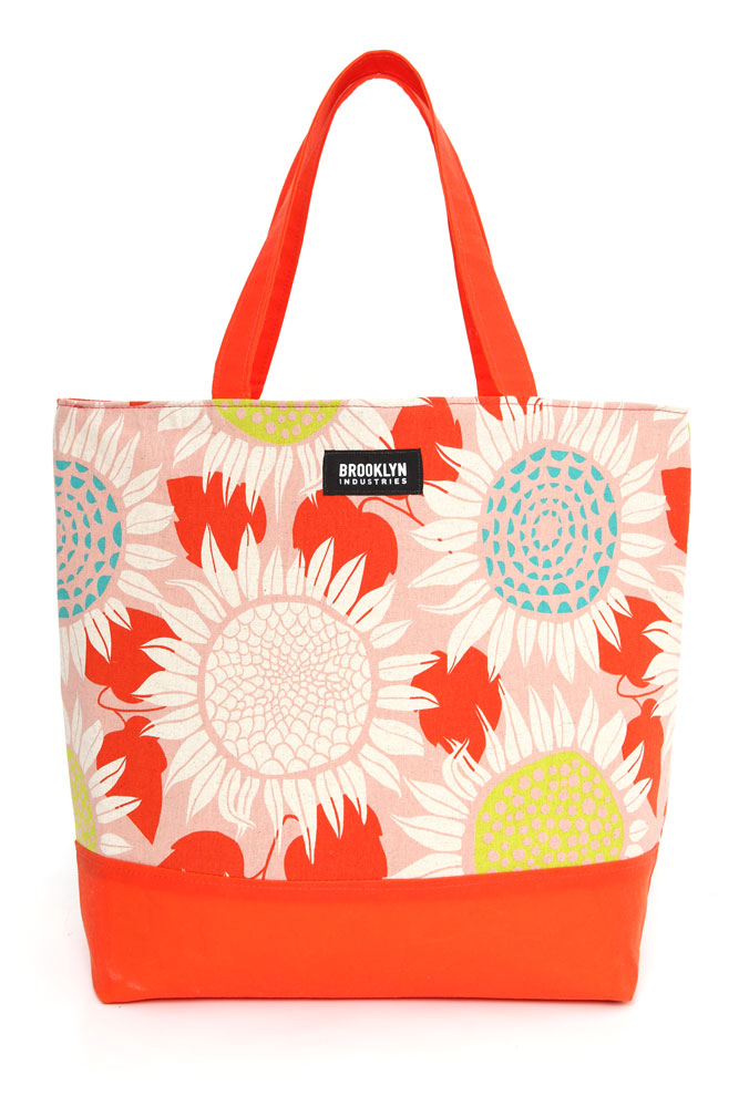 FRONT VIEW CANVAS TOTE BAG WITH SUNFLOWER GRAPHIC DESIGN TOP PANEL AND WAXED CANVAS IN ORANGE BOTTOM AND STRAPS