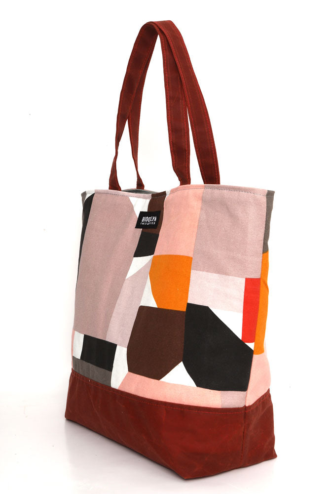 Large cotton canvas tote with waxed canvas handles and bottom.  60's geo pattern with burgundy wax, side view