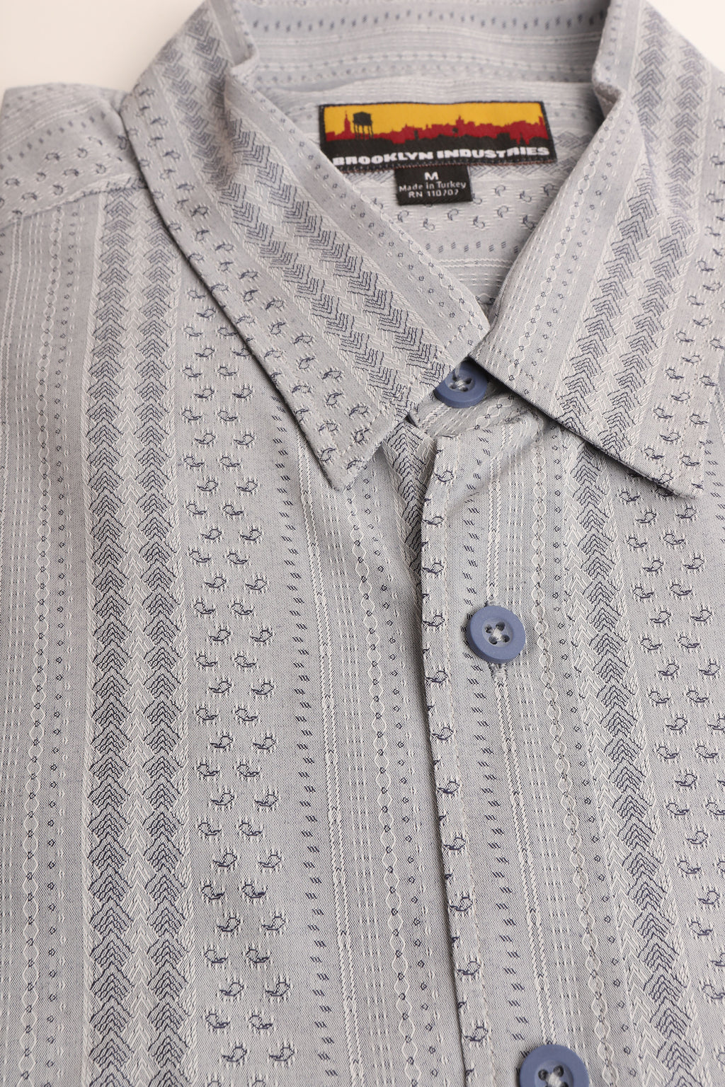 FOLDED SHIRT TO SHOW DETAIL ON GREY MIXED WOVEN SHIRT