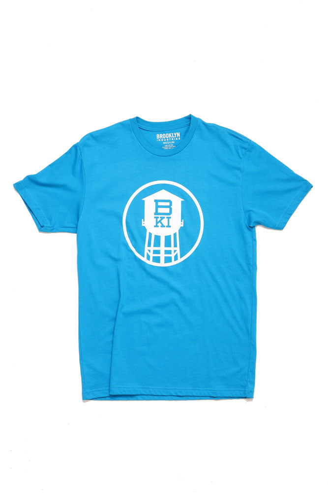 FLAT LAY IMAGE OF BKI HIGH TOWER TSHIRT BRIGHT BLUE WITH WHITE GRAPHIC OF WATERTOWER IN A CIRCLE