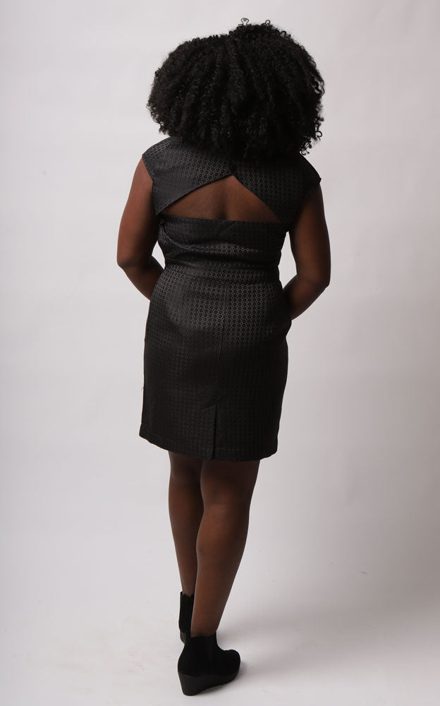 BACK VIEW OF CUT OUT MILLICENT DRESS IN JACQUARD ON MODEL