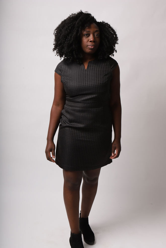 MODEL WITH AFRO WEARS BLACK SATIN JAQUARD DRESS