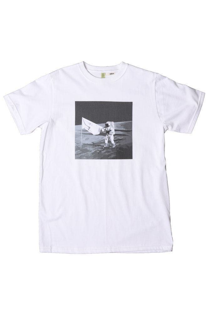 FLAT LAY WHITE TSHIRT WITH BLACK AND WHITE GRAPHIC OF A MAN ON THE MOON WITH FLAG