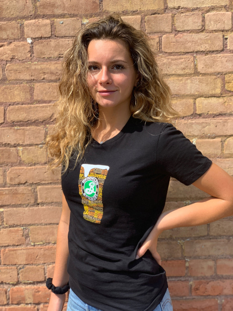 Women With Curly Hair Wearing a Black Tshirt With Brooklyn Brewery Pint Glass