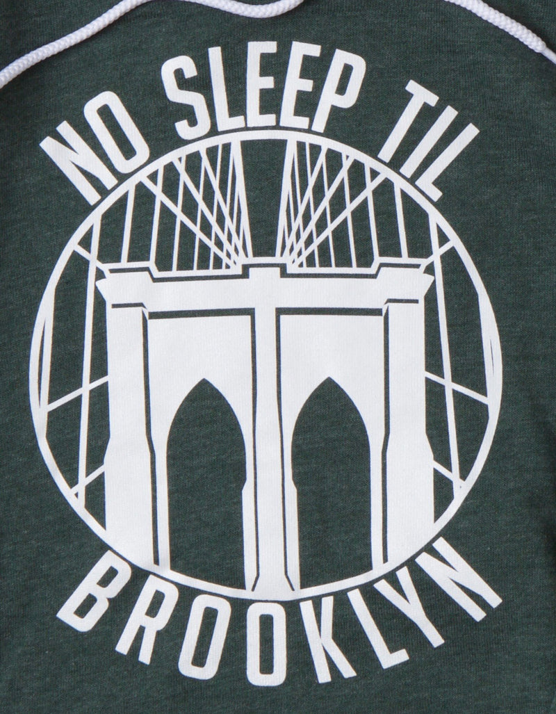 DETAIL OF NO SLEEP TIL BROOKLYN TEXT IN ROUND WITH BRIDGE GRAPHIC.   GREEN WITH WHITE