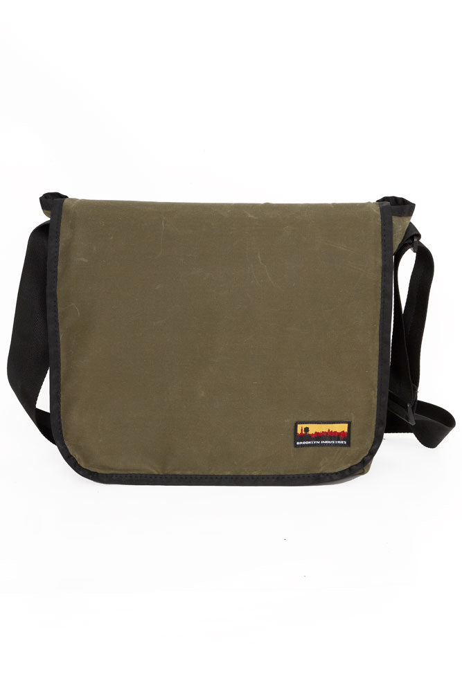 FRONT VIEW OF THE NEW AND IMPROVED WAVED CANVAS COURIER BAG - OLIVE WAX