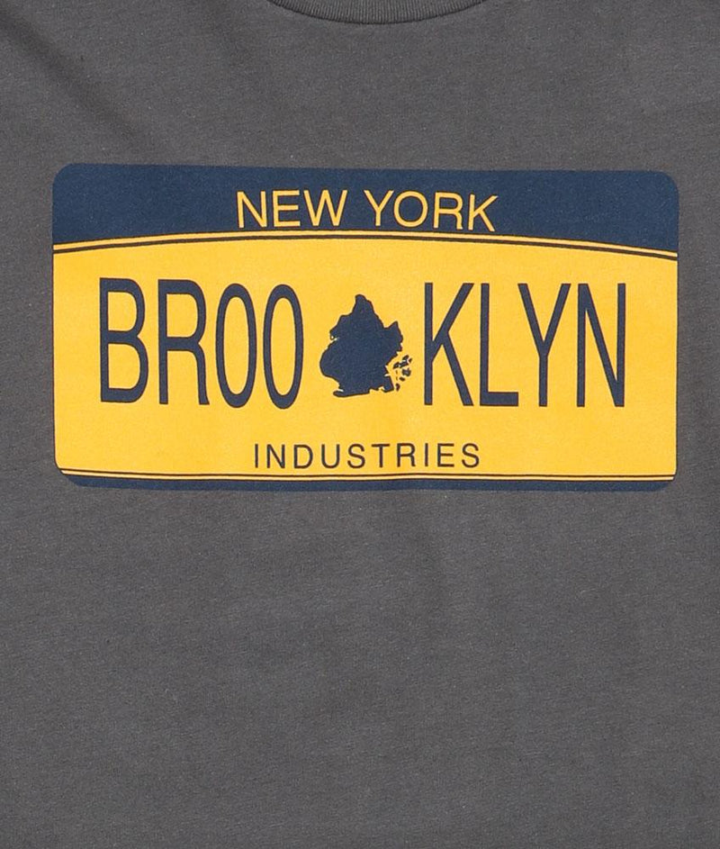DETAIL OF PLATE MENS TSHIRT  YELLOW AND BLUE NEW YORK STATE LICENSE PLATE THAT SAYS BROOKLYN