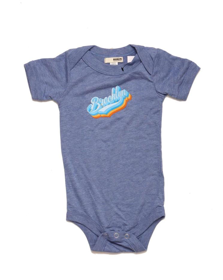 BLUE ONESIE WITH THE BK PLATFORM LOGO ON THE CHEST
