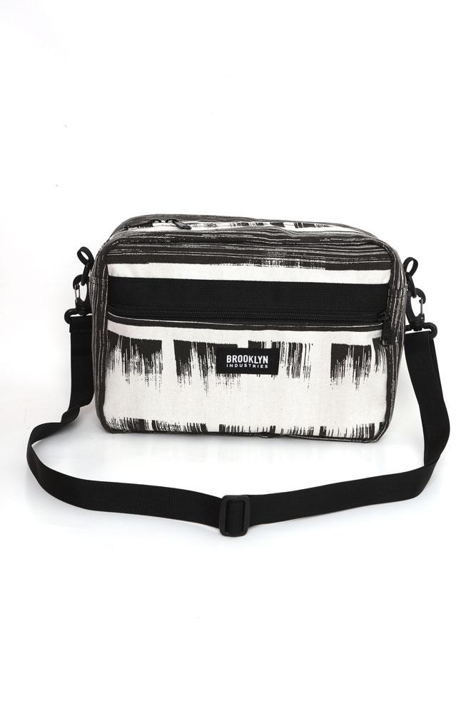 CROSS BODY BAG IN BLACK AND WHITE BRUSHED INK PATTERNED CANVAS , FRONT VIEW ON TABLE TOP