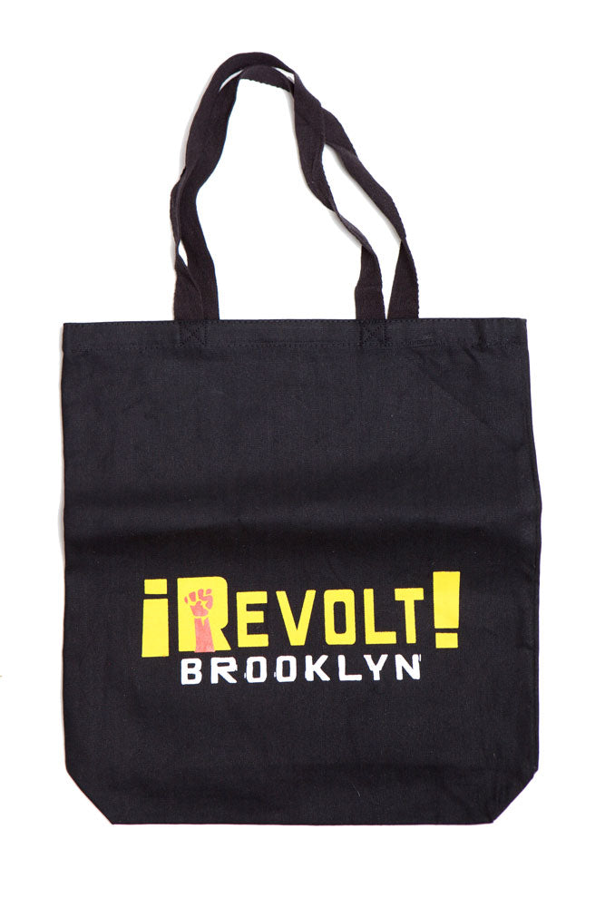 BLACK CANVAS TOTE BACK WITH REVOLT BROOKLYN IN YELLOW AND WHITE TEXT