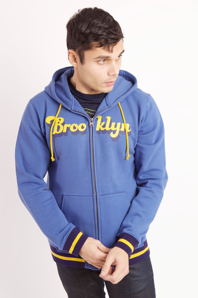 MAN STARTS TO ZIP BLUE RADICAL RIBBED SWEATSHIRT WITH YELLOW TEXT