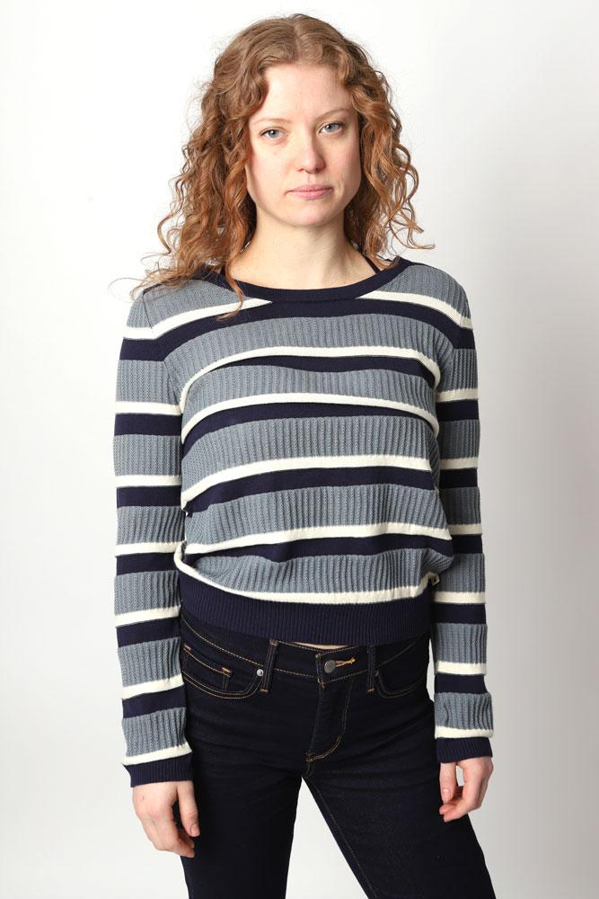 Women looks at camera in blue striped sweater