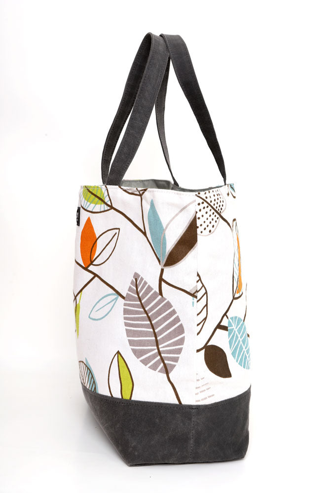 SIDE VIEW CANVAS TOTE BAG WITH LEAF DESIGN TOP PANEL AND WAXED CANVAS IN RHINO BOTTOM AND STRAPS