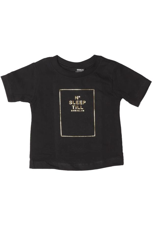 flat lay baby t-shirt with sleep number graphic in gold glitter