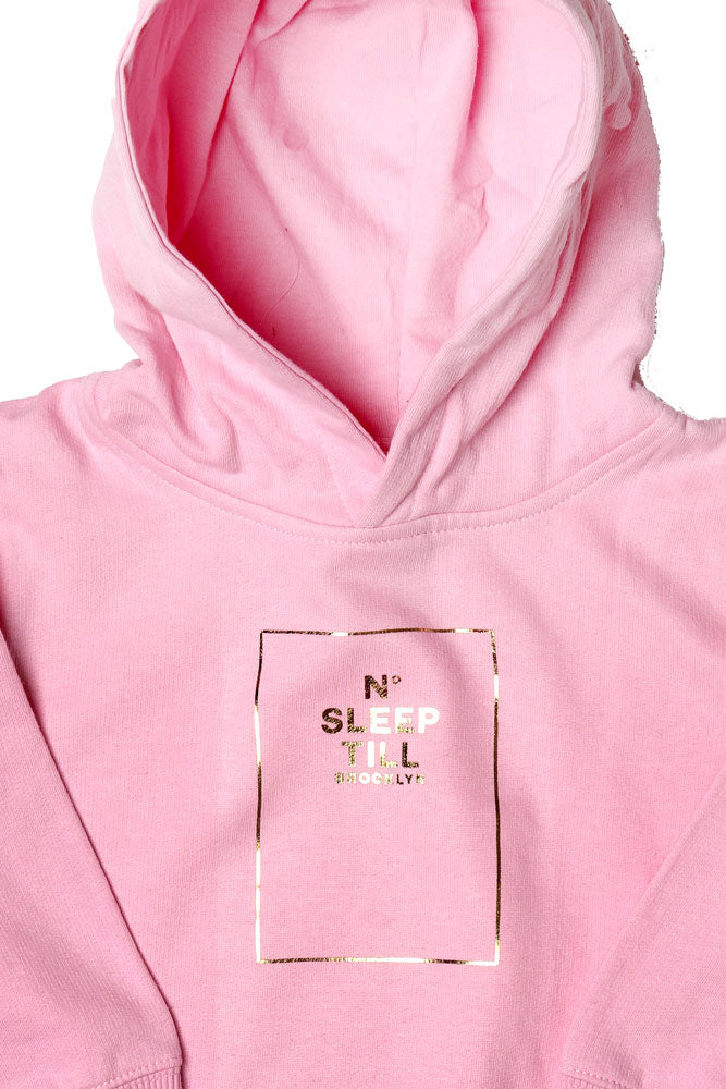 detail of TODDLER SIZED HOODED SWEATSHIRT WITH SLEEP NUMBER GRAPHIC IN GOLD. SWEATSHIRT IS PINK