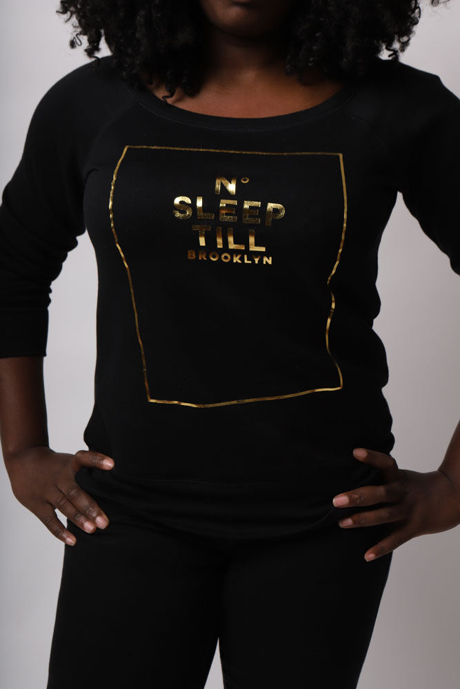 MODEL WEARS SLEEP NUMBER NO SLEEP TIL BROOKLYN SWEATSHIRT IN BLACK WITH FOLD LETTERING