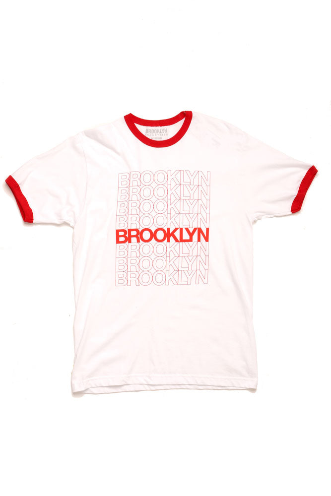 FLAT LAY OF WHITE TSHIRT WITH RED TRIM,  BROOKLYN REPEATED DOWN THE CHEST IN VARYING TEXT WEIGHTS.