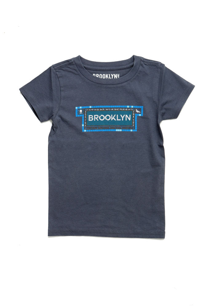 toddler sized t-shirt with graphic of tiled subway effect