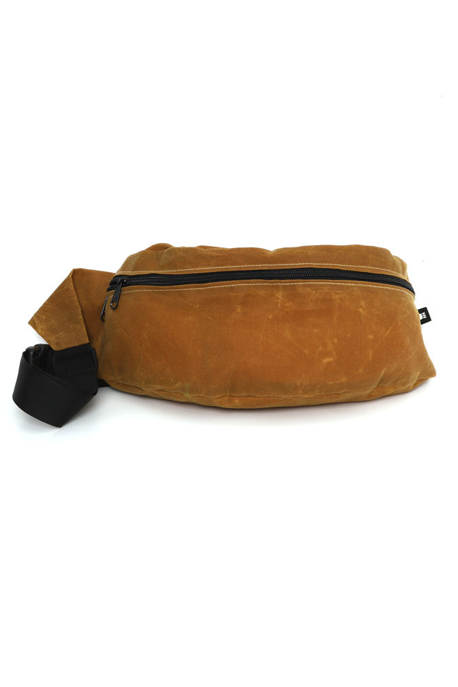 FRONT VIEW OF ZEKI WAISTPACK IN TOAST WAX CANVAS