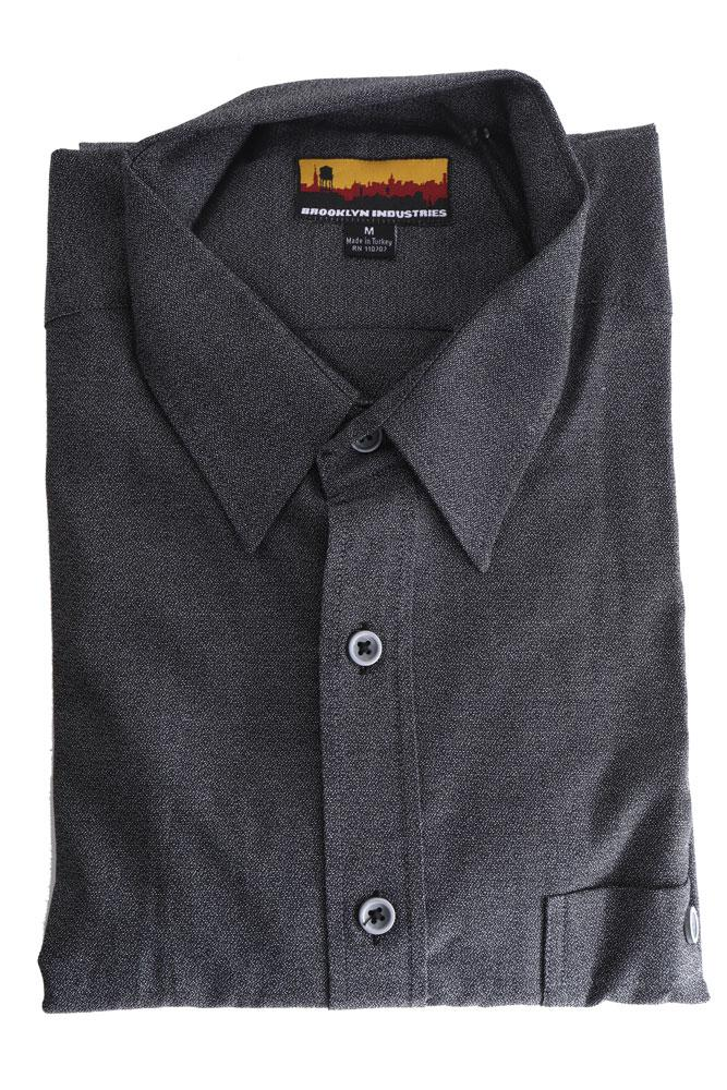folded black men's shirt to show texture of detail