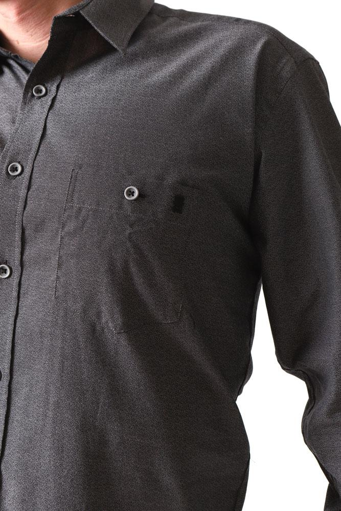 detail of the speckled black finish of westerlo woven shirt, and embroidered water tower on the pocket