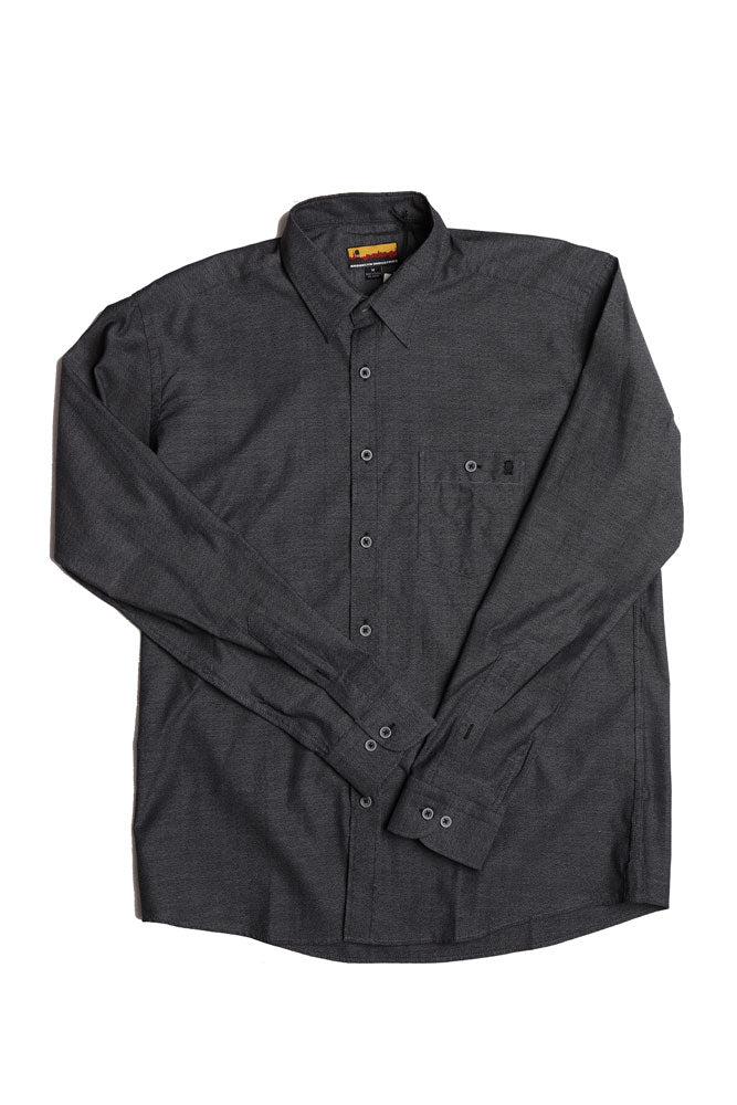 flat lay of black men's button up woven shirt with arms across body of shirt