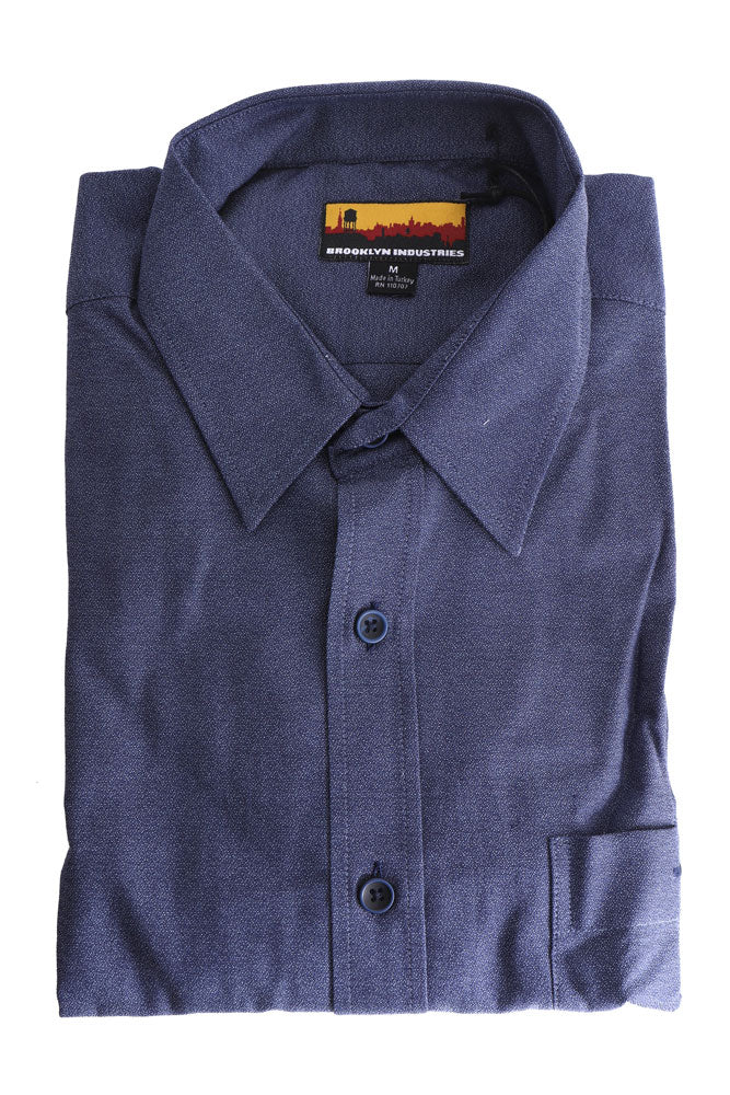 folded blue denim woven shirt with collar