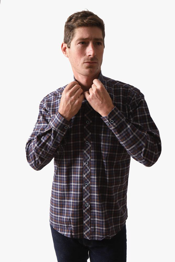man adjusts collar on westerlo malibu brown and blue plaid woven shirt