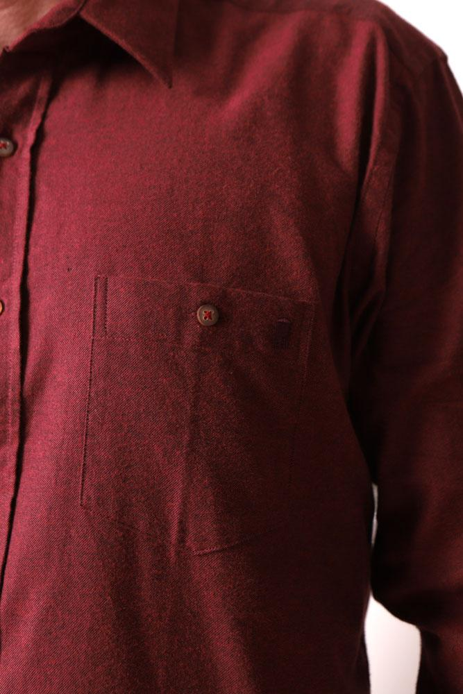 detail of embroidered water tower on chest of burgundy men's woven shirt