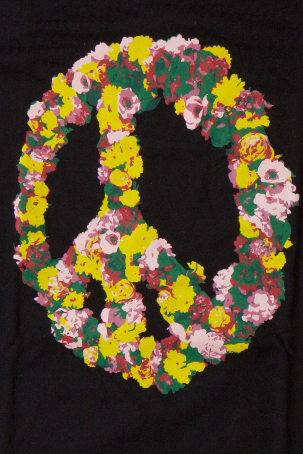 Detail Of Flowers In A Peace Sign Configuration On a Black TShirt