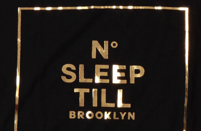 Detail of the No sleep till Brooklyn graphic on black Sleep Numbers tshirt