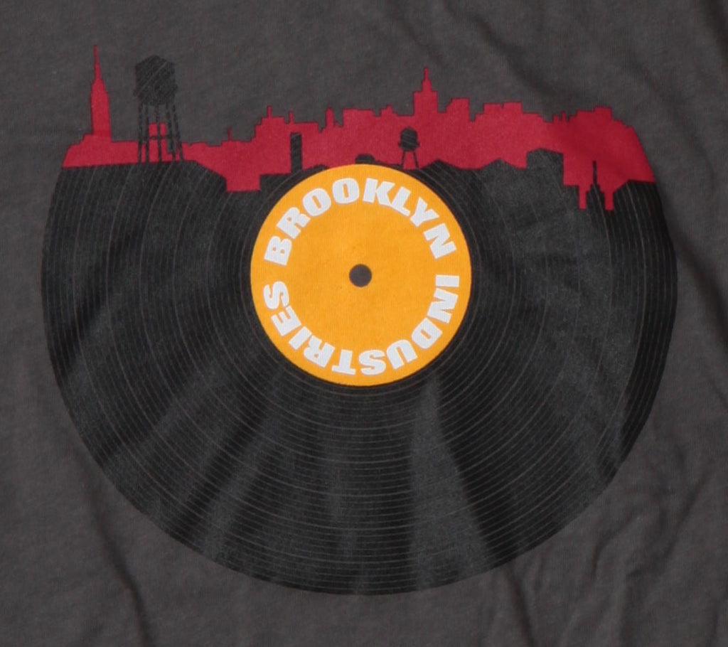 Half Black Record, with BROOKLYN INDUSTRIES In Center on Yellow. Top of Record BKI Logo in Red