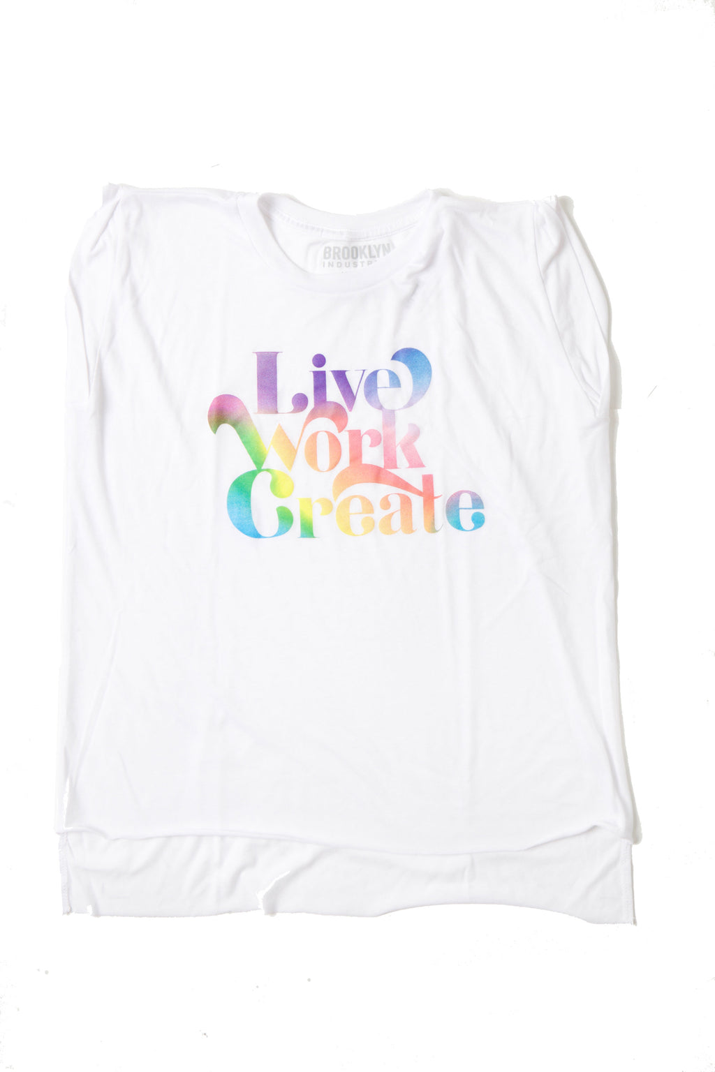 flat lay sheer capped sleeve white shirt with live work create in rainbow retro text