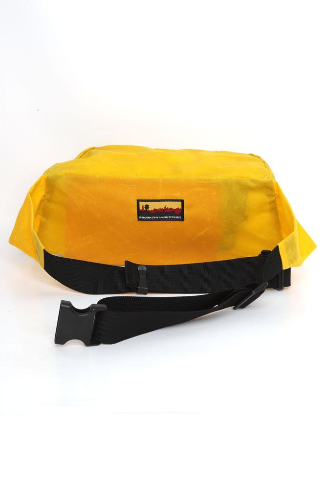 Back view yellow waxed waist pack with skyline logo