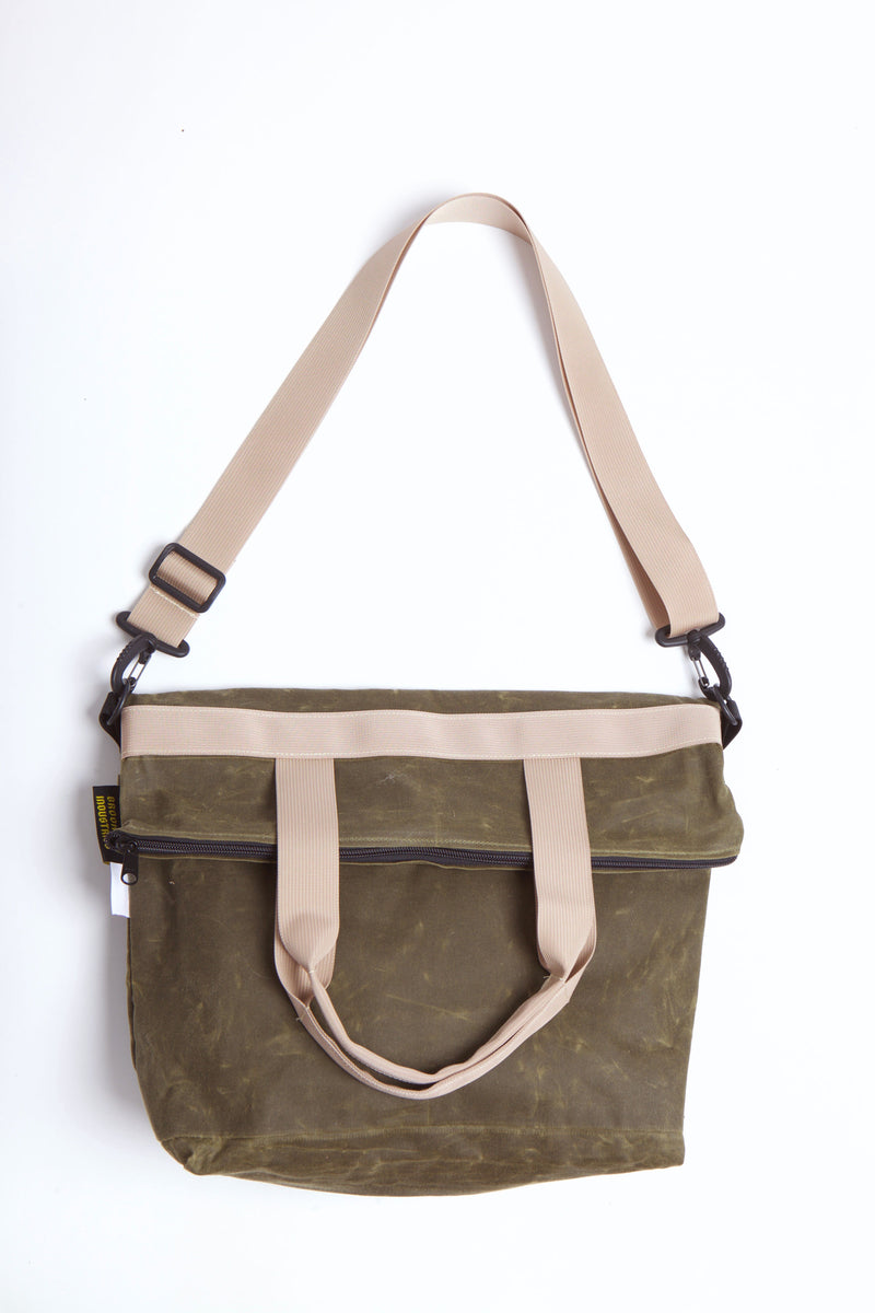 Waxed zip messenger bag in olive wax with tan handles and straps.
