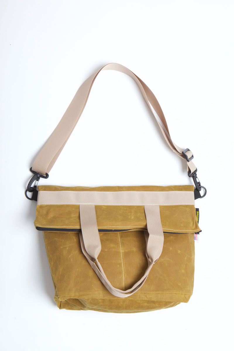 Waxed zip messenger bag in toast wax with tan handles and straps.